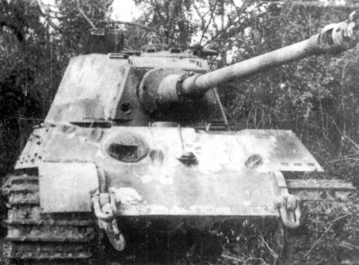 Knocked out Tiger II heavy tank, France, Aug 1944; note penetrated frontal turret armor