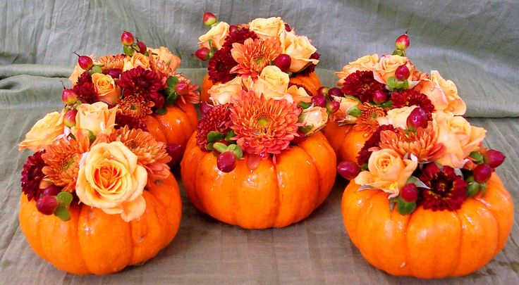 Mini pumpkins filled with fresh flowers for cocktail tables. White pumpkins would be good.