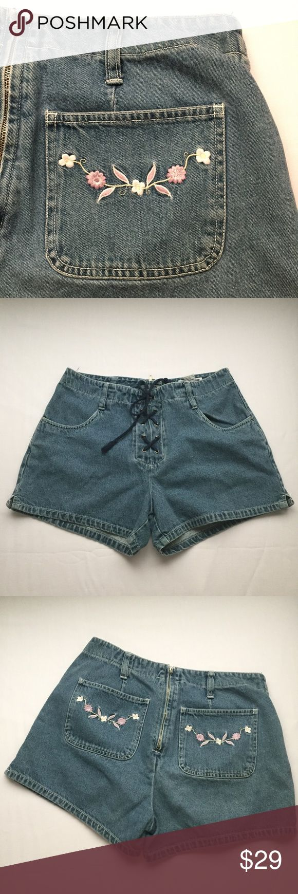 Lace Up Front Shorts Floral Embroidered Size 9 Used in good condition. Pink flowers on the back pockets. Super cute and definitely vintage. Measurements coming soon. Looks like it would fit high rise or high waisted ✨Approximate measurements (laying flat)✨ Waist: 13.5in Rise: 10.75in Xhilaration Shorts Jean Shorts