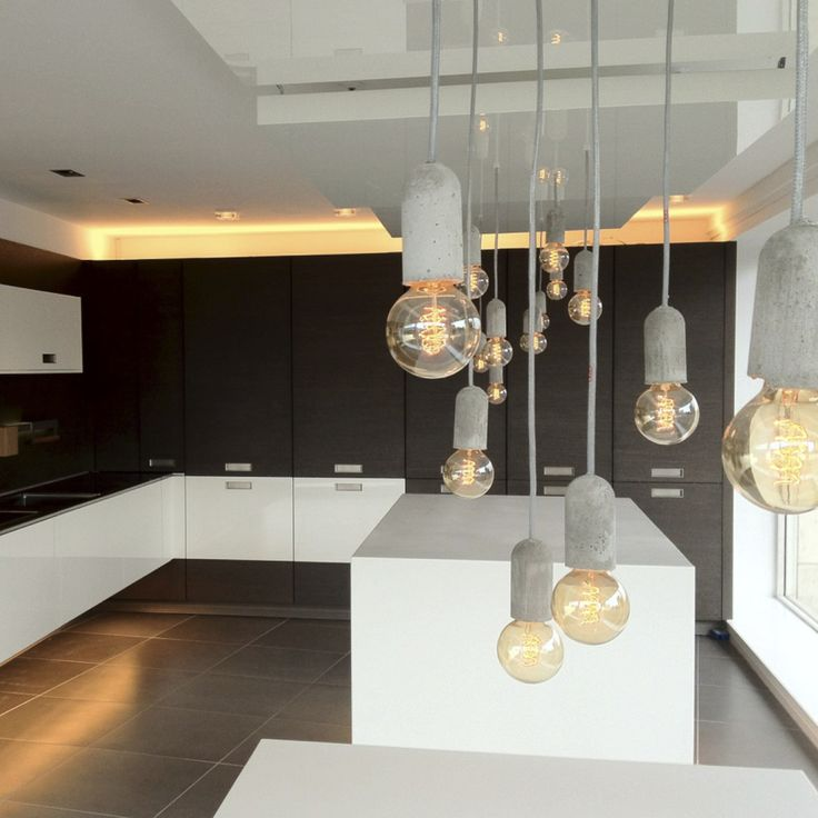 NUD Base Concrete pendant like hanging stars in a kitchen.