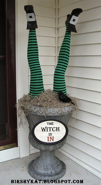 mannequin legs, tights, old shoes, urn, crow, moss, sign with glitter frame (rim of chinette plate), could also include broom - hilarious!