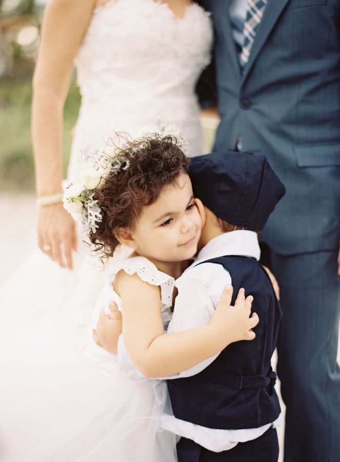 Ring bearer and flower girl hugging! How cute?!http://www.stylemepretty.com/2016/05/13/this-disney-inspired-wedding-is-the-ultimate-fairytale/ Photography: Ozzy Garcia - http://ozzygarcia.com/