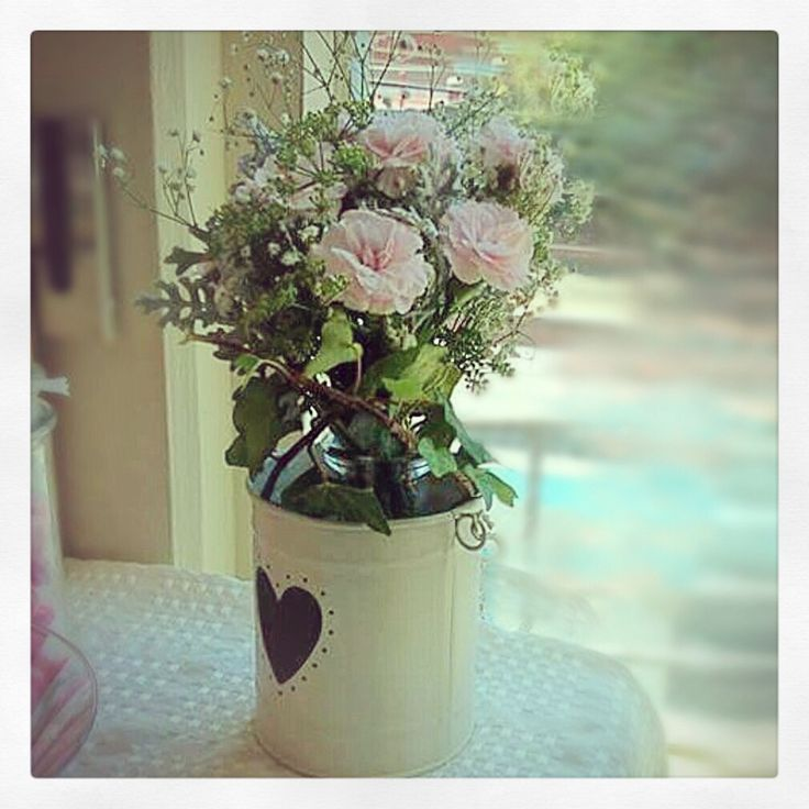 Bridal shower flowers by Lily+Moss that the bride to be put in our heart cut out tins. Carnations + babies breath.
