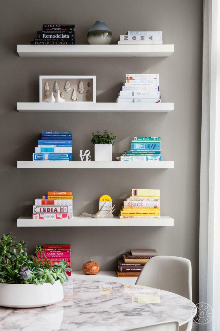 Our 30 Clutter Free Marie Kondo Approved Bookshelves Homepolish Dining Room Shelves Dining Room Floating Shelves Shelves