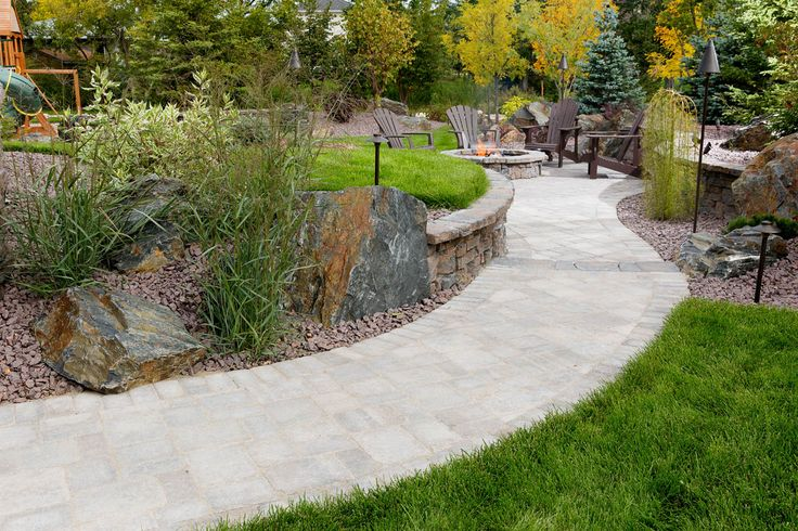 Roman pavers laid the path to the Belvedere Circle Firepit, a nice gathering place for family and friends.