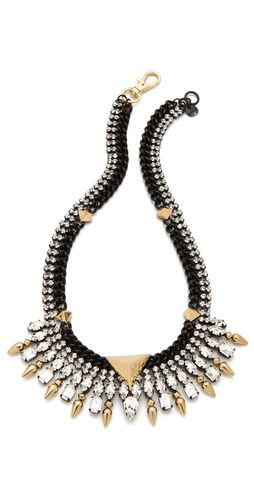Juicy Couture. Someone punch me in the face to make me stop obsessing over statement necklaces.