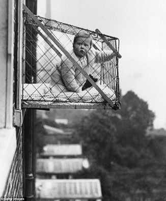 I just came across this photo of baby cages, used in East Poplar London during the 1930's. They were approved by East Poplar Council, as a way for babies living in highrises, to get fresh air and sunshine.