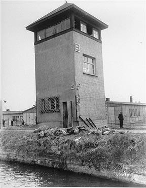 """Wachturm B - """"neutralized"""": A watch tower in Konzentrationslager Dachau. The personell of the tower  was probably shot by the American liberators. Photo from April 29. 1945."""