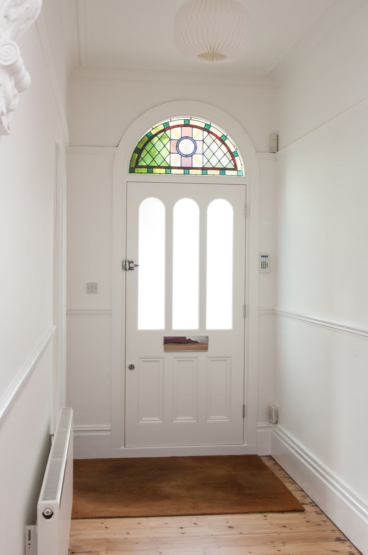 Eye-catching front door with detailed, stained glass fanlight. Perfect for traditional Period Properties