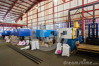 Plastic Injection molding machines in operation making customer products for the market