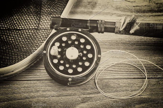 Old Fly fishing gear on rustic wood by Tigerpix LLC on @creativemarket