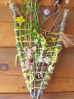 Weaving with items from our nature walks, to display on the nature table.