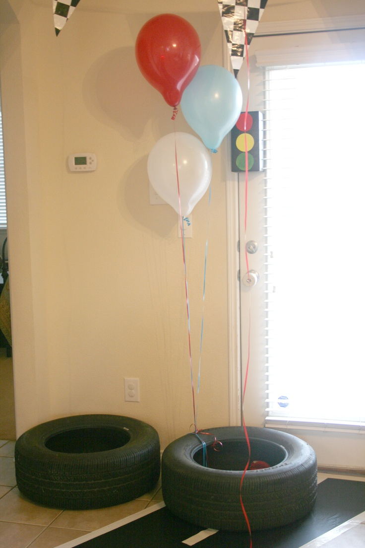 Race car party game. Bean bag toss into the tires. Kids loved it!