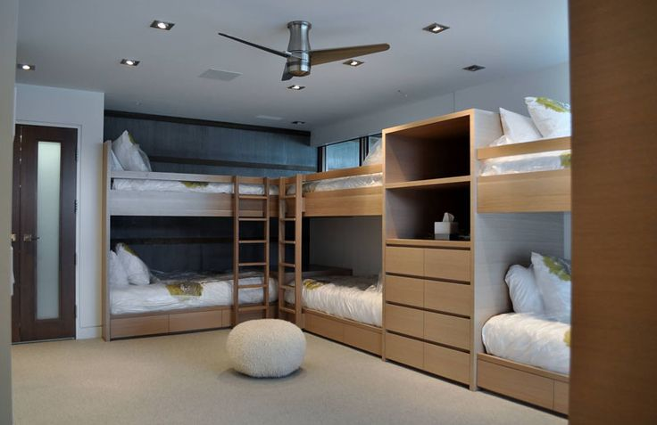 Interior Design Ideas For Sleeping Six People In A Room // These six bunks were designed and custom built by Accent Custom Furniture to fit the room perfectly.