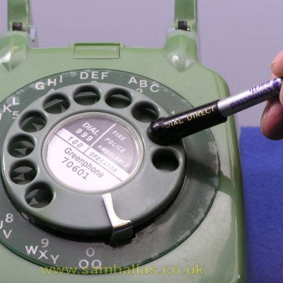 Using a pencil to dial phone.