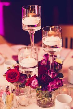 Floating candles as table centrepieces. Credits in comment.