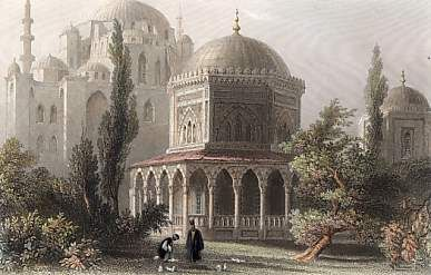 Mausoleum of Kanuni Sultan Suleyman and Roxalana. by W. H. Bartlett. Miss Pardoe, 'The Beauties of the Bosphorus', Londra 1838. Çelikbaskı. / Süleymaniye Külliyesi içinde yer almaktadır. Türbe Mîmar Sinan tarafından yapılmıştır. Kânûnî Sultan Süleyman'ın Zigetvar'da ölümü üzerine naaşının İstanbul'a getirilerek hazîrede türbe için ayrılan yerde toprağa verilmesinden sonra inşâ edilmiştir.