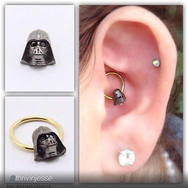 """thrivestudios:  by @thrivinjesse """"Daith piercing with a black gold """"Daith Vader"""" by @Leticia de Abreu Bustos. Need this in my life."""