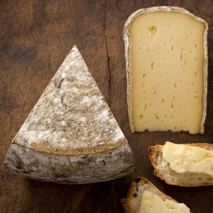 Tomme de Savoie: semi-soft, raw cow. rustic, earthy and milky. beige paste with a brown/grey natural rind.