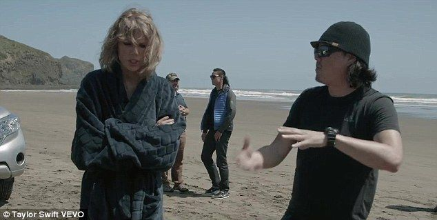 Beach: Taylor and director Joseph Kahn discuss her next scene on location in New Zealand