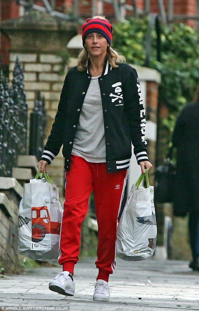 On the move: Nicole Appleton cut a slightly sombre figure as she stepped out for a leisure...