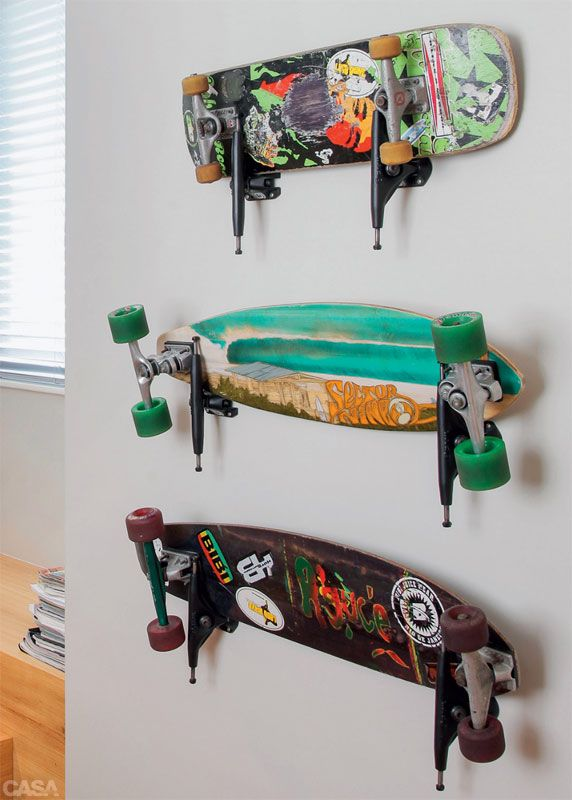 Trucks without wheels mounted on the wall to hold decks.