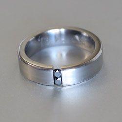 Titanium and black diamond tension ring