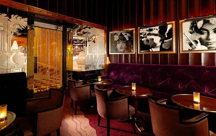 A dark and moody room for dining/conversation at Claridges Fumoir Bar.