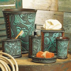 A hack to be??? Wonder if one could use metal trash cans or desk accessories, paint turquoise,overlay with lace and spray lightly with black.  Use a large motif lace.  Leave the edges and seams and paint copper.  Cool planter Idea