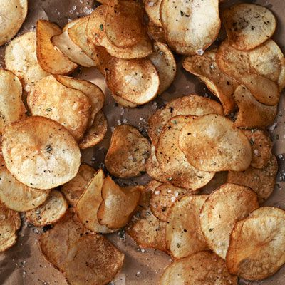 Crispy Rosemary Potato Chips, sprinkled with fresh rosemary, crunchy sea salt, and crackled pepper.