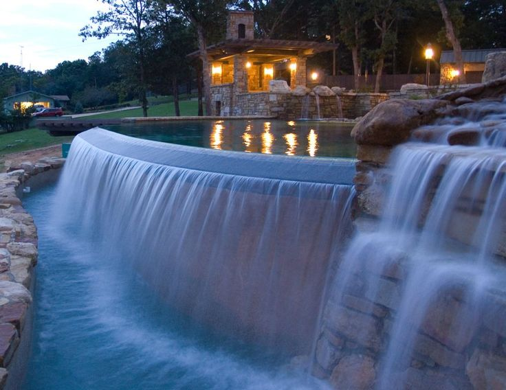 Imagine the soothing sounds of the waterfall and runoff from the infinity pool.  Great shot of this pool built by Memphis Pool in TN.
