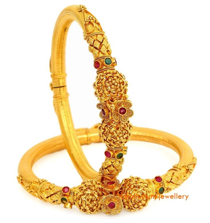 Beautifully Carved Gold Kadas More From Category:Ruby Emerald Bangles from Premraj JewellersAntique gold kada with man and baby carvingGold kada with floral carvingGold bangles studded with rubiesEmerald and diamond banglesGold Kada from Azva23 carat Thewa art gold kadaGold Kangan/Kada