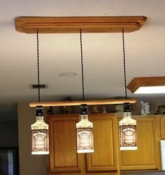Jack Daniels Light fixture With three lights from Jack Daniels bottles and oak on Etsy, $199.99