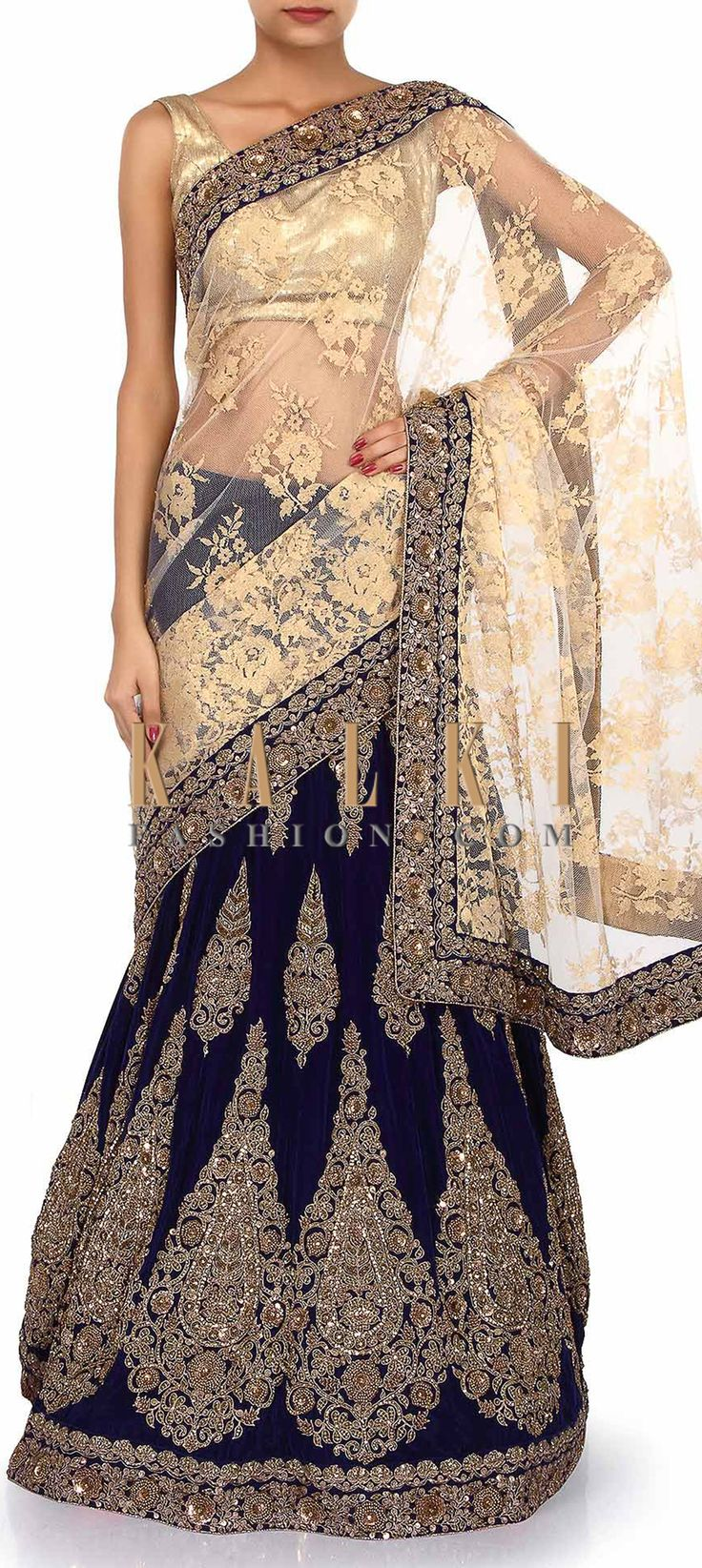 Buy Online from the link below. We ship worldwide (Free Shipping over US$100). Product SKU - 254644. Product Link - http://www.kalkifashion.com/lehenga-saree-adorn-in-gold-and-navy-blue-with-zardosi-embroidery-only-on-kalki.html