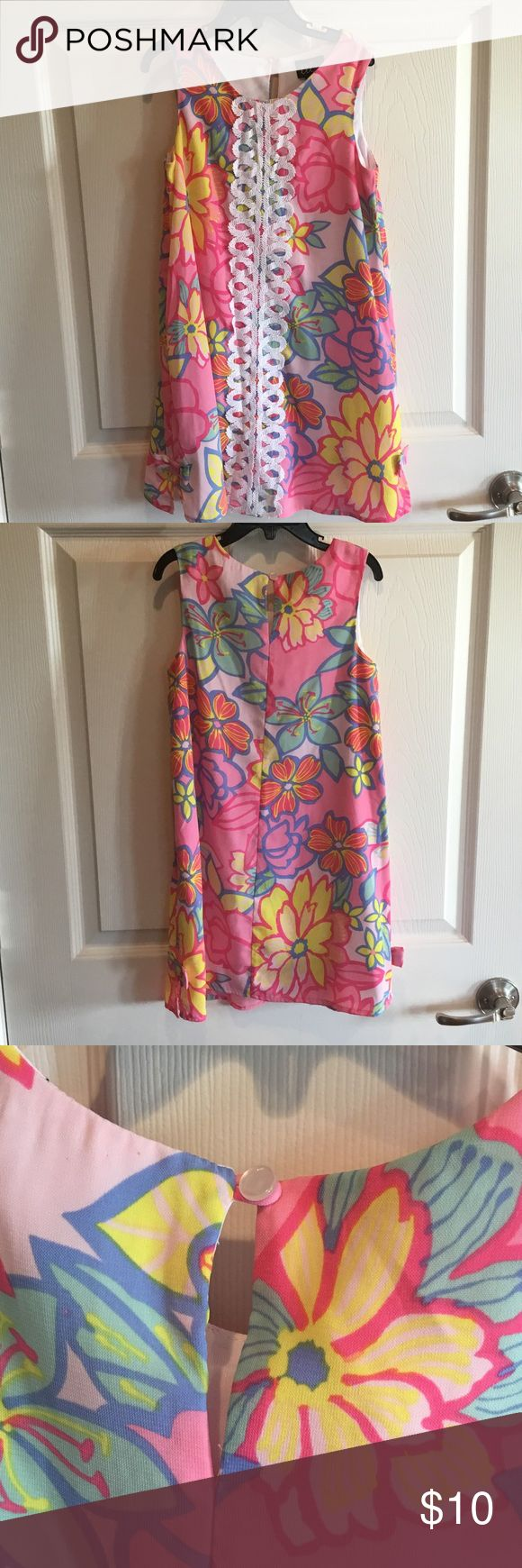 Lilt Floral Tank Dress Fun Floral Dress with white trim down the center, worn once, both side seams have a bow at the bottom of the dress (shown in picture), self, lining, and lace trim all 100% polyester Lilt Dresses Midi