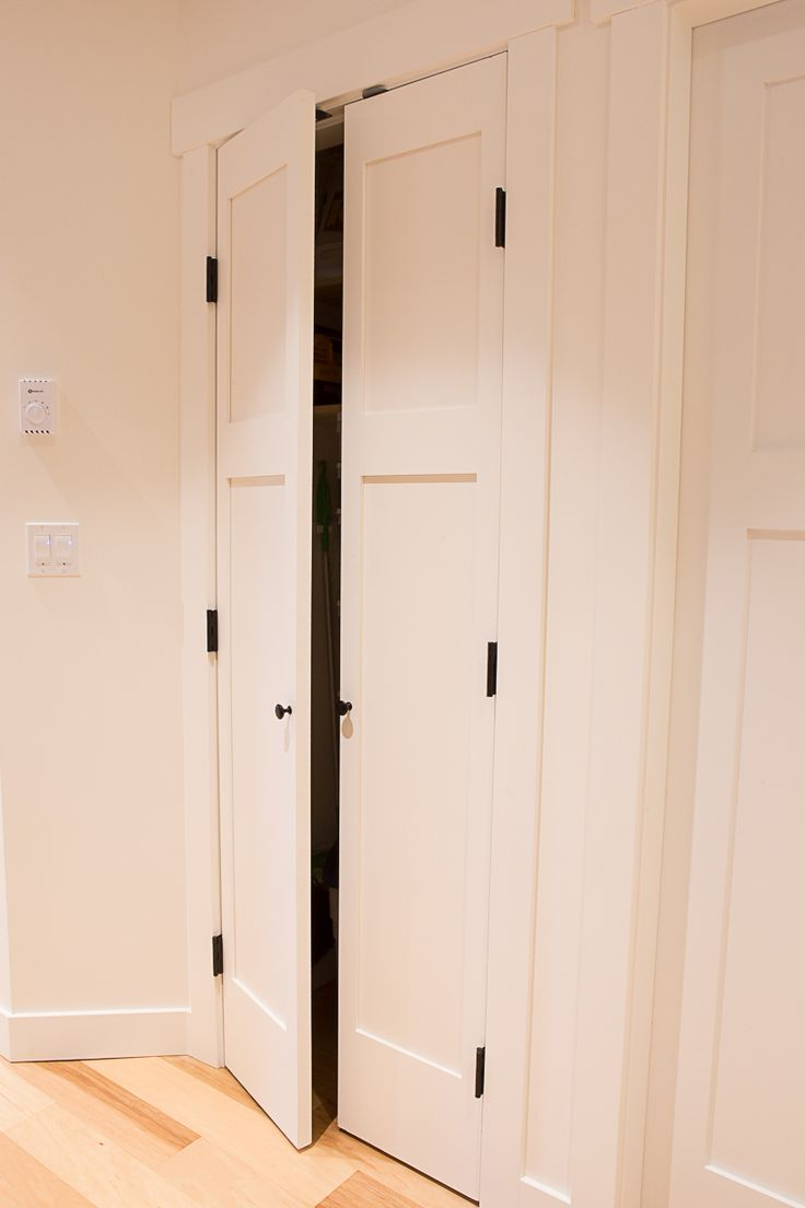 Craftsman style closet door with matte black hardware for Matte black kitchen doors