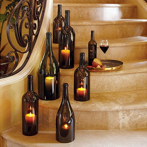 Glass Bottle Candle Covers - Will make my own out of our old bottles. A cluster on one side with tea lights will look dramatic.
