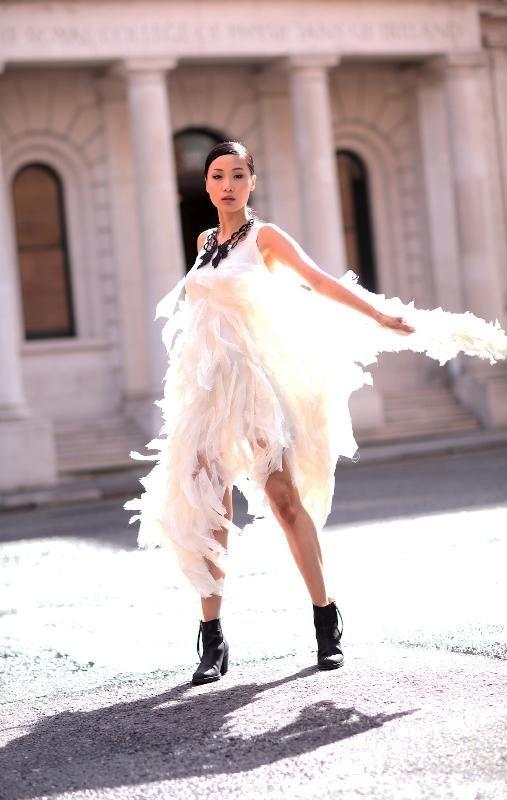 Yomiko Chen wearing cream silk chiffon feather dress by Eilis Boyle