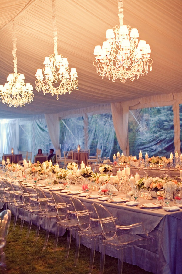 I'm loving this outdoor seating arrangement, the chandeliers, and the transparent chairs