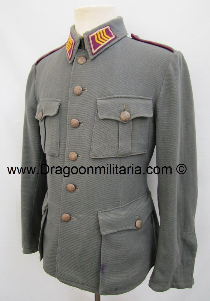 Early pattern with rounded branch colored shoulderboards. Heavy wool cabardine jacket with engineer staff-sergeant collartabs. Jacket marked int 50B. Copper colored buttons. .