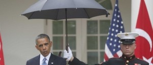 Obama violates Marine regulations by having a uniformed Marine hold an umbrella (and he is using his RIGHT hand which is mandated to be free for salutations). Also, Obama violated Flag Protocol: the US flag is flying at the same heighth as the Turkish Islamic flag, which should be flying LOWER than the US Flag.