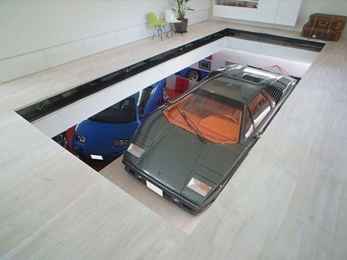Car elevates into the living room.