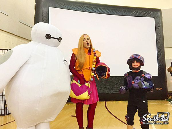Turn your Big Hero 6 Movie Night at Church into an interactive experience with movie themed costumes of Baymax, Hiro and Honey Lemon.  - A movie night event idea from Southern Outdoor Cinema of Atlanta.