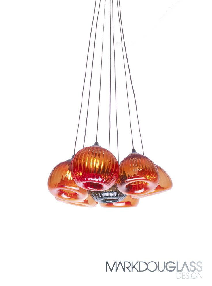 Atolla is a handblown bell shaped glass with a large rolled inversion, open or closed and distinct ribbing.