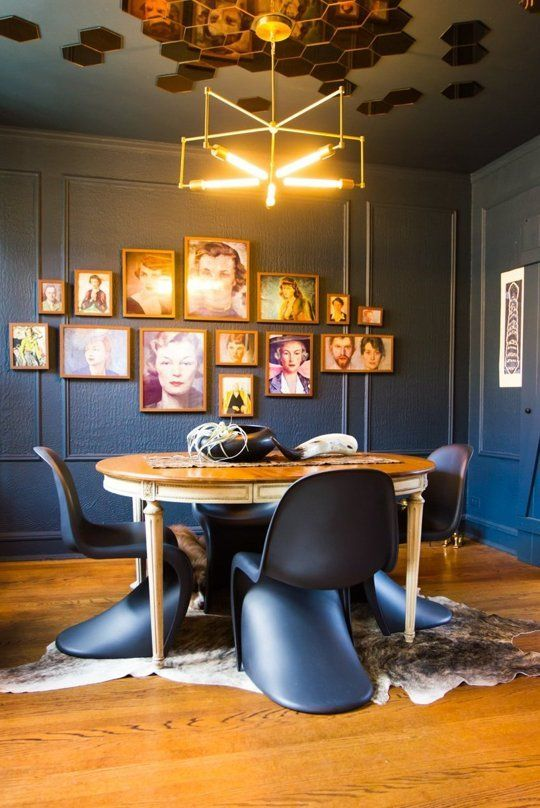A quirky but effective ceiling treatment - both the colour and the bronze mirror tiles.  Odd in a bedroom, gorgeous in a dining space.  And I love the dog hiding just behind the table!