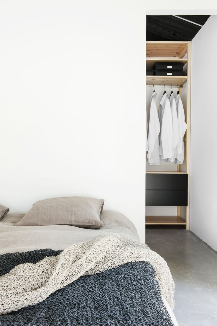 I'm really not into white joinery for walk in robes at the moment. Love the glimpse of joinery and the finishes used in this bedroom.