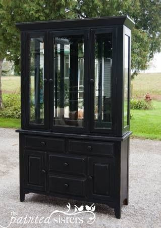 Large black china cabinet painted with Amy Howard black paint, waxed with Annie Sloan wax and distressed!
