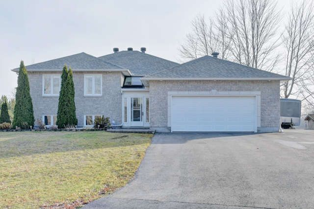 BOURGET $400,000 Bright open concept & well kept 3 + 2 bed bungalow on a generous lot. Complete fin'd lower level w/fireplace, wrap around deck w/screen in gazebo & more..Just move right in