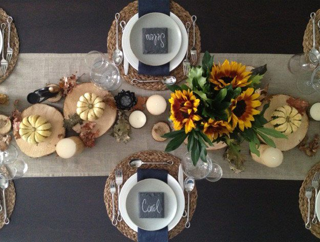 Cheerful sunflowers mixed with small gourds and candles, like this setting by Nyla Free Designs Inc., creates a beautiful scene for a more casual Thanksgiving gathering.
