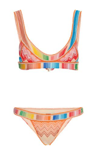 Founded in the 1950s by Ottavio and Rosita Missoni, the house cultivates a cult following for its striking, jolie-laide knits in kaleidoscopic colors. For Resort, Angela Missoni draws from the abstract art of Sonia Delaunay for a thoroughly painterly collection, resulting in this vivid **Missoni** bikini set that contrasts a rainbow striped band against the house's signature zig zags in a '90s-influenced silhouette.